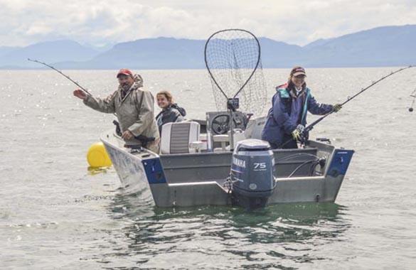 Driving a Boat at Doc Warner's Lodge in Juneau Alaska